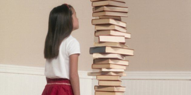 Girl by Stack of