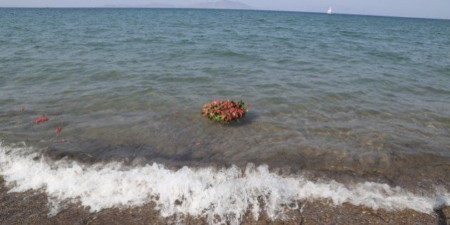 MUGLA, TURKEY - SEPTEMBER 4: Flowers are seen in the sea as people commemorate Aylan Kurdi, the three-year-old...