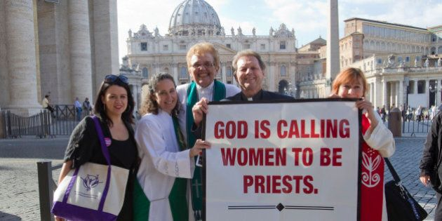 From right, Janice Sevre, Reverend Roy Bourgeois, Ree Hudson, Donna Rougeux and Erin Saizhanna, members...