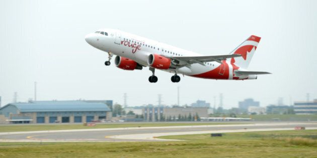 MISSISSAUGA, ON - JULY 1: Air Canada Rouge Airbus A319 takes its inaugural flight on Canada Day at Pearson...