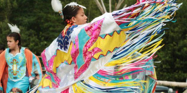 Jennifer Maloney performs a traditional native