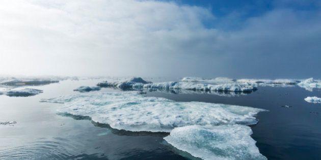 Canada, Nunavut Territory, Summer fog above melting sea ice in Hudson Bay near Arctic Circle