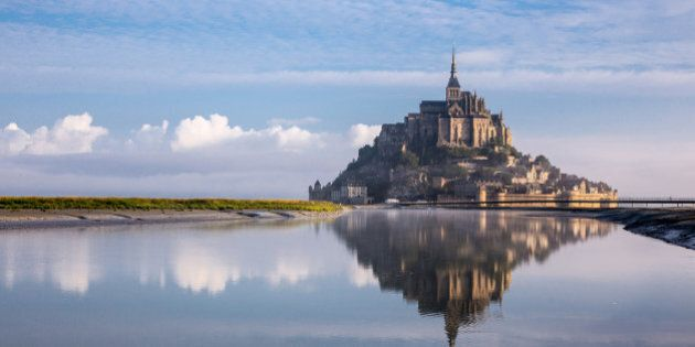 reflection on water of Mont St Michel at