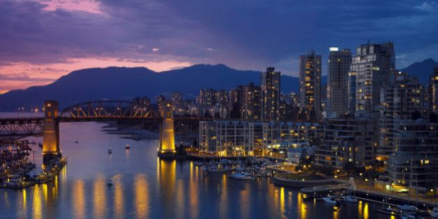 Yaletown and the Burrard Bridge in False Creek in the city of Vancouver, British Columbia in