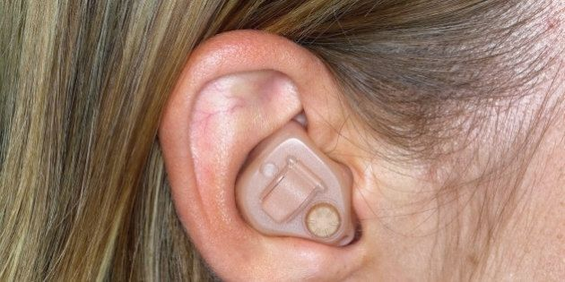 Woman with hearing aid, close up