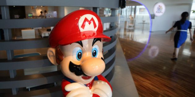 A statue of Nintendo Co.'s video-game character Mario stands at the company's showroom in Tokyo, Japan,...
