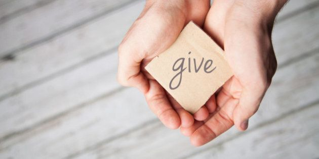 Two hands offering to give, donate or