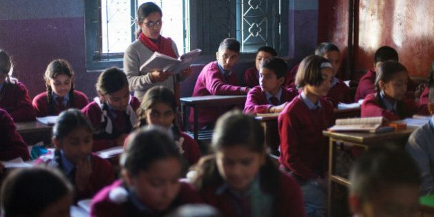 In a picture taken on November 21, 2012, Drishti Silwal (back row L), a 12 year old Brahmin Nepali girl...