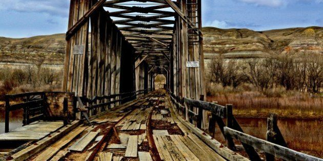 [UNVERIFIED CONTENT] Taken on May 9th 2009.This abandoned railway bridge is a testament to days past when the railway ushered cars to the the Atlas Coal Mine located near East Coulee in the Alberta Badlands south of Drumheller Canada.