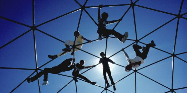 Low angle view of children on a jungle gym