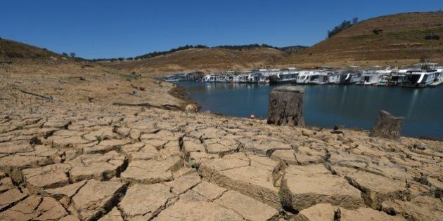 Dried mud and the remnants of a marina is seen at the New Melones Lake reservoir which is now at less...