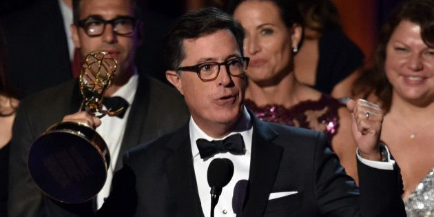 LOS ANGELES, CA - AUGUST 25: TV personality Stephen Colbert accepts Outstanding Variety Series for 'The Colbert Report' onstage at the 66th Annual Primetime Emmy Awards held at Nokia Theatre L.A. Live on August 25, 2014 in Los Angeles, California. (Photo by Kevin Winter/Getty Images)