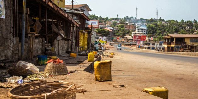 A usually busy street is deserted as Sierra Leone enters the second day of a three day country wide lockdown on movement of people due to the Ebola virus in the city of Freetown, Sierra Leone, Saturday, March 28, 2015. Guinea has deployed security forces to the country's southwest in response to reports that Sierra Leoneans are crossing the border to flee an Ebola lockdown intended to stamp out the deadly disease, an official said Saturday. (AP Photo/ Michael Duff)