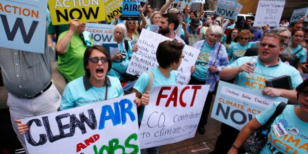 Some 300 environmental activists yell their support for stricter pollution rules proposed by the Environmental...