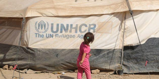 ARBIL, IRAQ - JULY 17: Iraqi kid is seen near UNCHR tent at Hazer refugee camp as Antonio Guterres (not...
