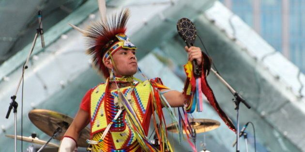 [UNVERIFIED CONTENT] First nations performer at the Canada Day celebrations in downtown Vancouver.performer,...