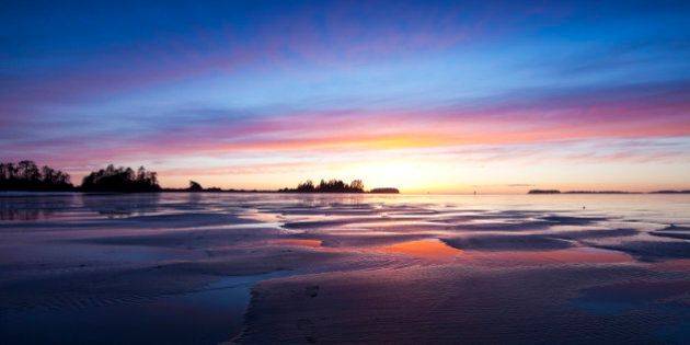 Twilight falls over Chesterman Beach at low tide, Chesterman Beach, Tofino, West Coast Vancouver Island, British Columbia, Canada