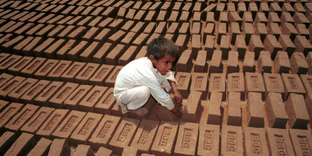Undated file photo of child labor turning bricks to be baked in sun at Kiln a suburb of Islamabad. About...