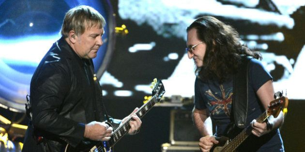 LOS ANGELES, CA - APRIL 18: Inductees Alex Lifeson and Geddy Lee of Rush perform on stage at the 28th...