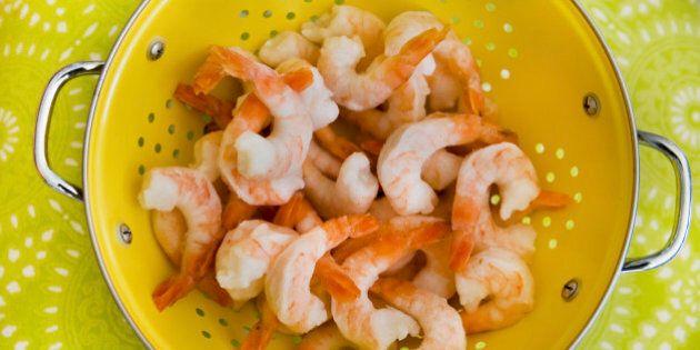 Frozen shrimps in a strainer
