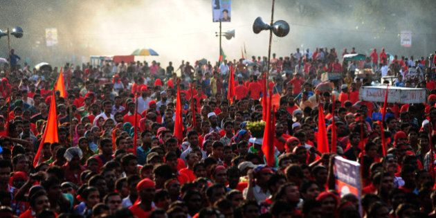 Bangladeshi garment workers shout slogans during a protest asking for wage increase in Dhaka on September...
