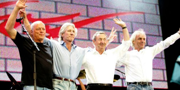 LONDON - JULY 02:  (L to R)  David Gilmour, Roger Waters, Nick Mason and Rick Wright from the band Pink Floyd on stage at 'Live 8 London' in Hyde Park on July 2, 2005 in London, England.  The free concert is one of ten simultaneous international gigs including Philadelphia, Berlin, Rome, Paris, Barrie, Tokyo, Cornwall, Moscow and Johannesburg. The concerts precede the G8 summit (July 6-8) to raising awareness for MAKEpovertyHISTORY.  (Photo by MJ Kim/Getty Images)