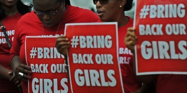Nigerian women living in Kenya demonstrate to press for the release of Nigerian school girls kidnapped...