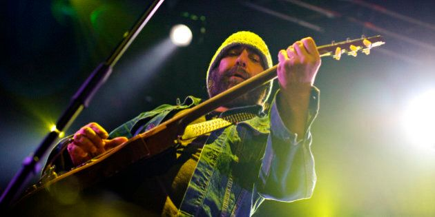 Canadian producer, guitarist, and songwriter Daniel Lanois performs with his band 'Black Dub' during...