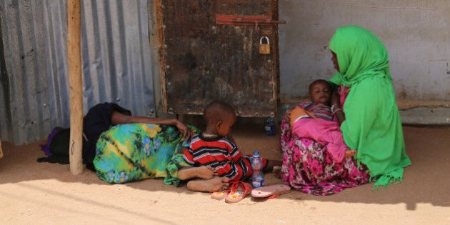 DADAAB, KENYA - OCTOBER 12: This photo taken on October 4, 2014 shows two refugee women resting with...