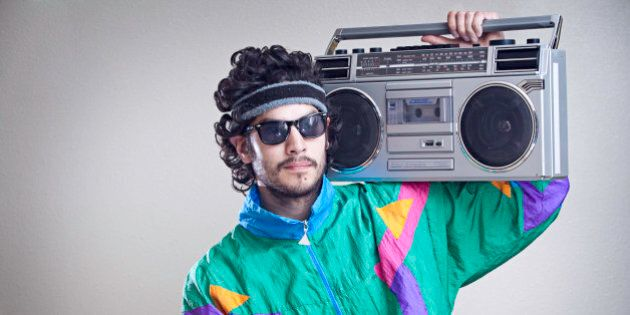 A cool, funky young hipster adult from the late 20th century complete with mullet, boom box 'ghetto blaster'...