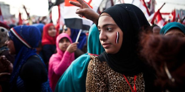 Egyptians wave the national flag in Cairo's Tahrir Square during a rally marking the anniversary of the...