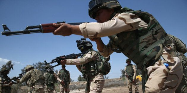 TAJI, IRAQ - APRIL 12:  Iraqi Army recruits train with U.S. Army trainers at a military base on April 12, 2015 in Taji, Iraq. U.S. forces, currently operating in 5 large bases throught the country, are training thousands of Iraqi Army combat troops, trying to rebuild a force they had origninally trained before the U.S. withdrawal from Iraq in 2010. Members of the U.S. Army's 5-73 CAV, 3BCT, 82nd Airborne Division are teaching members of the newly-formed 15th Division of the Iraqi Army, as the Iraqi government launches offensives to try to recover territory lost to ISIS last year. (Photo by John Moore/Getty Images)