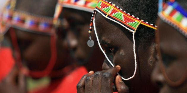 Kenyan teenage Maasai girls attend an alternative right of passage at Kilgoris, Trans Mara district, 220 kilometres north-west of the capital Nairobi, on April 19, 2008 at a ceremony organised by an anti-female genital mutilation, (FGM) campaign, Cherish Others Organisation. The World Health Organisation estimates that between 100 and 132 million girls and women around the world have been subjected to the 'cut' and despite having been outlawed FGM is still regarded as a crucial tradition in some Kenyan communities regardless of its negative physical and psychological health repercussions.   AFP PHOTO/TONY KARUMBA (Photo credit should read TONY KARUMBA/AFP/Getty Images)