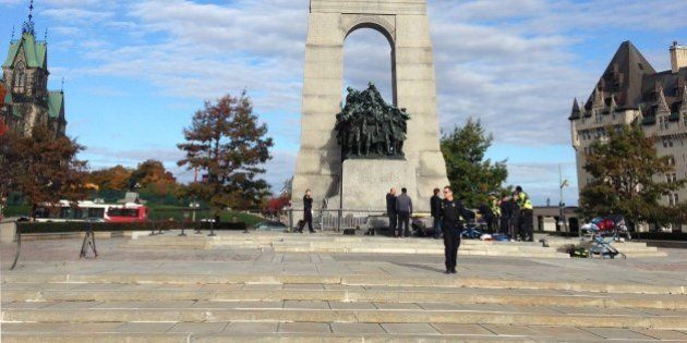 This October 22, 2014 photo shows police at the scene of a shooting at the National War Memorial in Ottawa,...