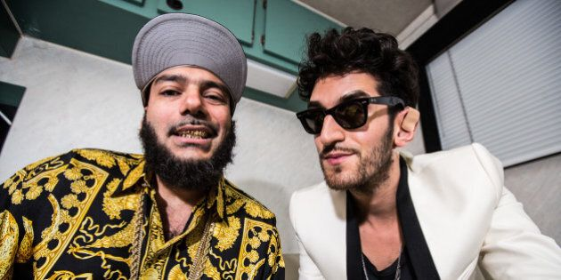 LOS ANGELES, CA - AUGUST 03:  DJs P-Thugg (L) and Dave 1 of Chromeo pose backstage at HARD Summer music festival at Los Angeles Historical Park on August 3, 2012 in Los Angeles, California.  (Photo by Chelsea Lauren/WireImage)