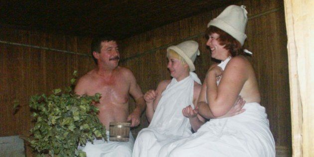 A man and two women in a sauna (banya) of the sanatorium 'slavino', one of the best of its kind in the...