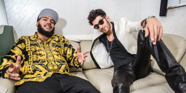LOS ANGELES, CA - AUGUST 03: DJs P-Thugg (L) and Dave 1 of Chromeo pose backstage at HARD Summer music...