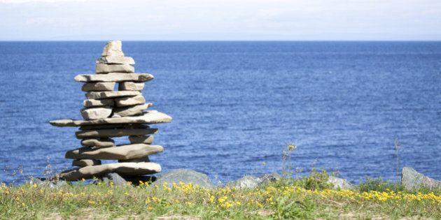 Inukshuk in front of the blue ocean, Canada. Emblem of the Olympic Winter Games 2010 Inukshuk was used...