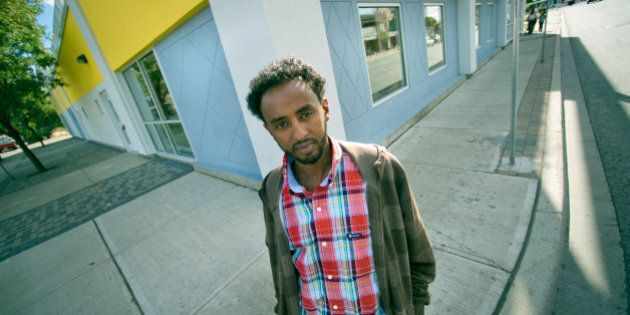 09/14/10 - TORONTO, ONTARIO - Nahom Berhane, of the centre, stands outside the colorful building. Access...