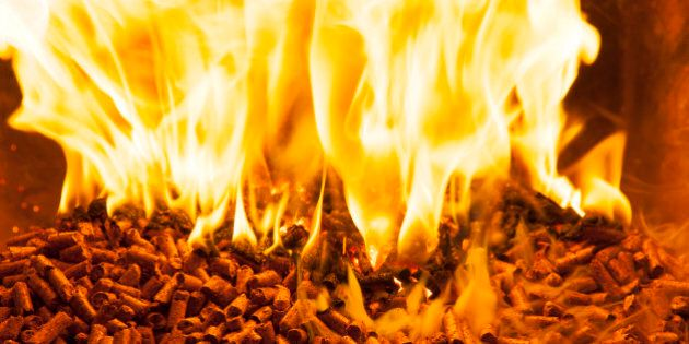 Closeup of burning wood pellets in oven.