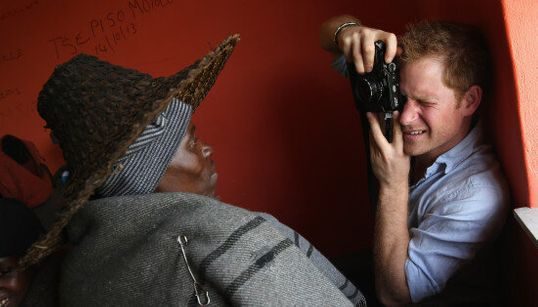 Prince Harry Plays Photographer In Charity Visit To African
