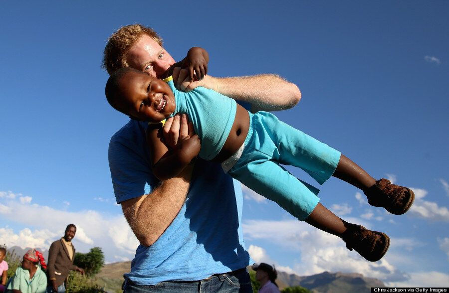 Prince Harry Plays Photographer During Charity Visit To Lesotho