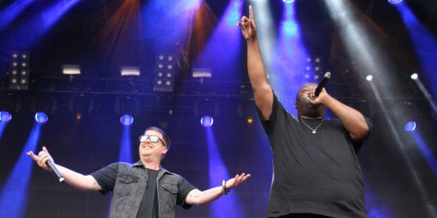El-P and Killer Mike with Run the Jewels performing as part of the CounterPoint Music Festival on Sunday, Apr. 27, 2014, in Kingston Downs, GA. (Photo by Robb D. Cohen/Invision/AP)