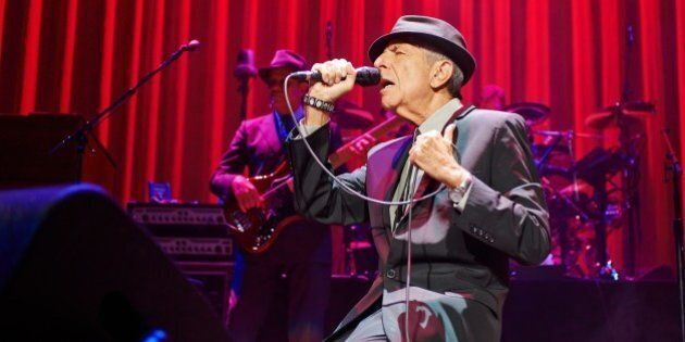 LEEDS, UNITED KINGDOM - SEPTEMBER 07: Leonard Cohen performs on stage at Leeds Arena on September 7, 2013 in Leeds, England. (Photo by Gary Wolstenholme/Redferns via Getty Images)