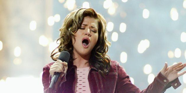 American Idol winner Kelly Clarkson sings after winning the contest at the Kodak Theatre in Hollywood,...