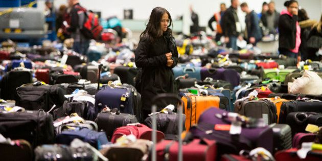 TORONTO, ON - JANUARY 7: Travellers scour the baggage claim at Toronto's Pearson airport for their luggage....