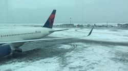 Plane From Toronto Slides Off Runway At