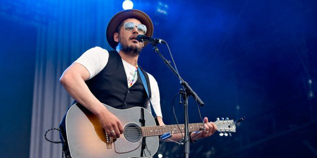 Adrian Sutherland, frontman for Midnight Shine, performs on the City Stage at 2017 Ottawa Bluesfest.