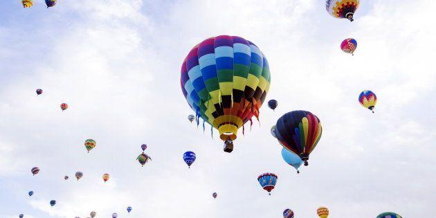 Hot air balloons lift off during the 2015 Albuquerque International Balloon Fiesta in Albuquerque, New...
