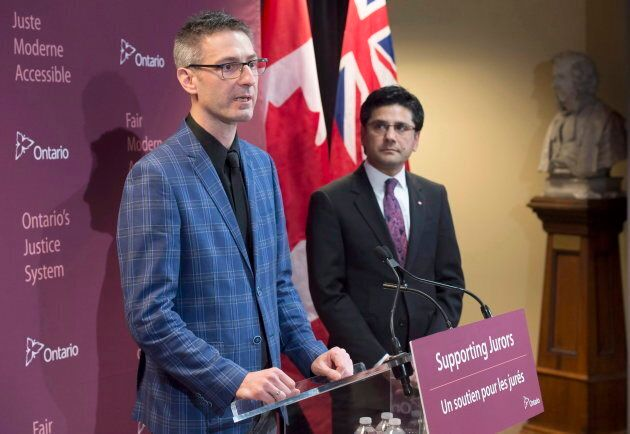 Former Ontario Attorney General Yasir Naqvi (right) listens as Mark Farrant speaks at the announcement...